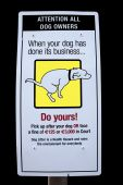 picture of pooper  - sign warning about fines for dogs fouling isolated on black - JPG