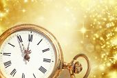 New Year's at midnight - Old golden clock with stars and snowflakes