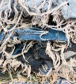 Heap Of Blue Jeans Denim Torn Tear Thread