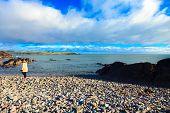 Irish Landscape. Coastline Atlantic Coast County Cork, Ireland. Woman Walking