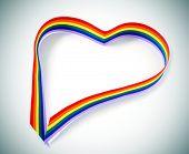 closeup of a rainbow ribbon forming a heart