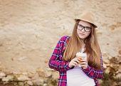 image of girl walking away  - Teenage hipster girl enjoying her take away drink walking down the city street - JPG