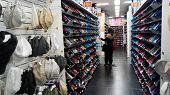 Customer Shops For Shoes In A Shop In Melaka