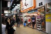 HONG KONG - NOVEMBER 14, 2012: Small shops working in the evening time in Mong Kok district very pop