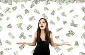 picture of indian money  - Stock image of woman standing with open arms amidst falling money - JPG