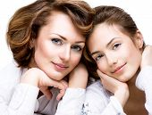 Mother and Teen Daughter. Close-up portrait of attractive happy mother and smiling teenage daughter