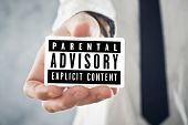 Businessman Holding Card With Parental Advisory Label