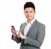 Businessan using mobile phone for message