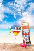 Fresh tropical cocktail on beautiful sunny beach - molecular mixology