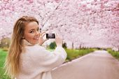 Pretty Young Woman Shooting Spring Blossom Park