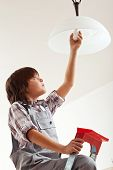 Boy Changing Lightbulb
