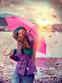 girl in a stormy day with pink umbrella