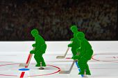 picture of bandy stick  - Three hockey players in a middle of field - JPG