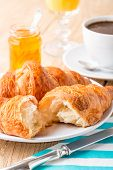 Croissants with orange jam and coffee.