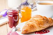 Croissants with raspberry and orange jam.