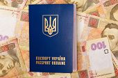 stock photo of passport cover  - International Ukrainian passport on Hryvna banknotes background - JPG
