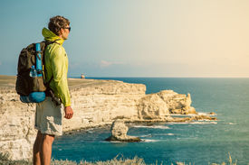 picture of boy scout  - Man Traveler with backpack relaxing outdoor Sea and Rocks coastal on background Freedom Lifestyle concept - JPG