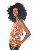 picture of mayhem  - Black woman in retro afro hairstyle and colorful clothing. Leather pants
