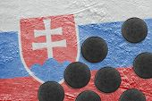 image of hockey arena  - Washers and the image of the Slovak flag on a hockey rink - JPG