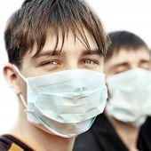 Teenager In Flu Mask