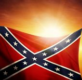 image of flag confederate  - Confederate flag in front of bright sky - JPG