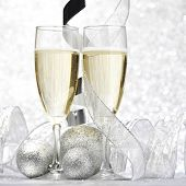 Champagne and decor on silver bokeh background