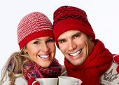 Christmas couple closeup isolated over white background.