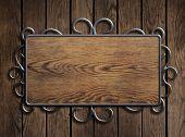 Old wood plate in metal frame on vintage door