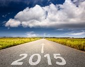 Driving On An Empty Road To Upcoming 2015