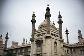 Architectural detail of the Brighton Royal Pavilion showing the Indian influence in the ornate rooftop and domes of this royal pleasure palace and popular landmark