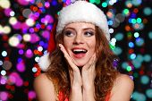 Portrait of beautiful young woman on bright lights background