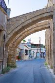 picture of larnaca  - The narrow street with the buttresses of the old mosque Larnaca Cyprus - JPG