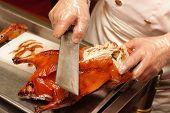 Cutting Of Peking Roast Duck