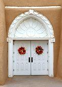 The white door to the San Francisco de Asis Church in Taos, New Mexico