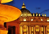 view of the Basilica of Saint Peter, in Vatican City, Italy at night