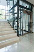 pic of elevators  - Elevator next to staircase in business centre