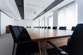 stock photo of enormous  - Enormous table in a meeting room horizontal
