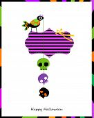 halloween card with bird and hanging skulls