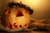 Halloween Pumpkin on wooden table, on color background