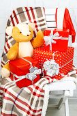 Christmas presents on blanket on white chair closeup