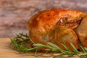 roasted chicken on wooden background