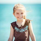 cute little girl run on tropical beach vacation