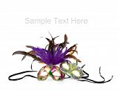 picture of mardi gras mask  - Purple green and gold mardi gras masks on a white background with copy space - JPG