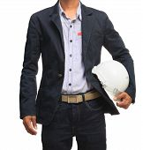 young working man and safety helmet standing isolated white background