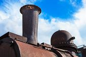 old steam locomotive pipe against the sky