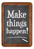 Make things happen motivational advice or reminder - chalk text on a vintage blackboard