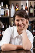 image of bartender  - Vertical view of female bartender at work - JPG