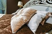 image of pillowcase  - Luxury hotel room setting with bed and a pillows - JPG