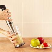 stock photo of blender  - Hands chefs mixed fruit smoothie in the blender - JPG