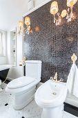 stock photo of chandelier  - Vertical view of crystal chandeliers in luxury toilet - JPG